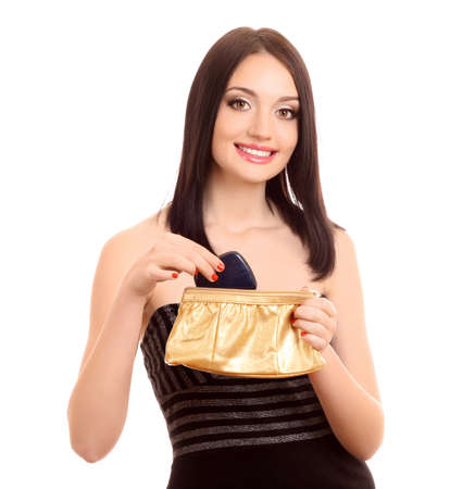 Beautiful young woman with  cosmetics bag photo