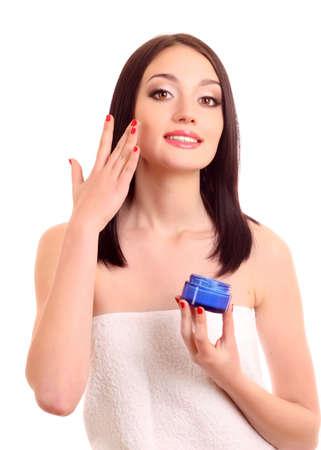 Beauty caucasian young woman applying  cream photo