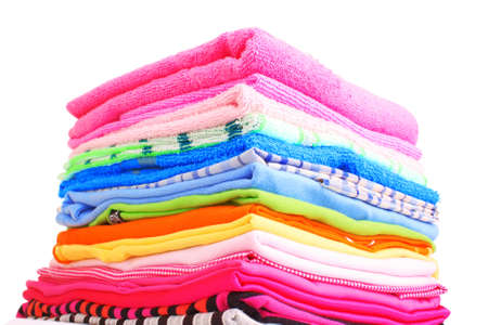 Pile of colorful clothes over white background Stock Photo - 9633323
