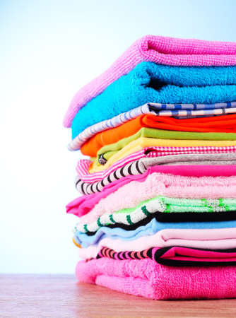 fold: Pile of colorful clothes over blue background