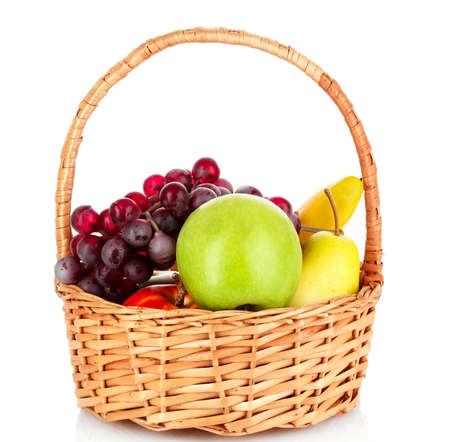 basket with fruits isolated on white photo