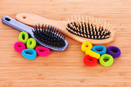 scrunchy: Hair Brush and hair scrunchies on brown background Stock Photo