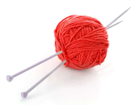 knitting needles and wool ball isolated on white