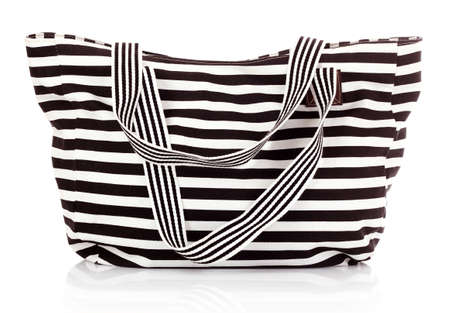 Striped women bag isolated on white background photo
