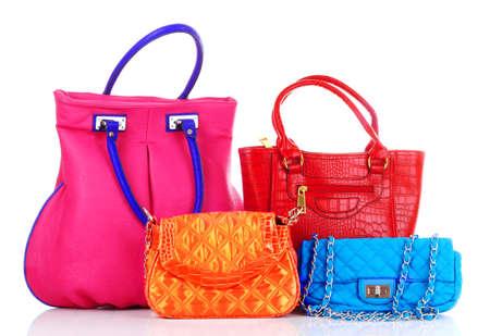 Muchas bolsas de las mujeres de color en blanco