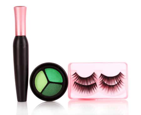 eyeshadows  and mascara and false eyelashes isolated on white photo