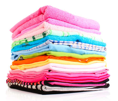 pile of clothes: Pile of colorful clothes over white background
