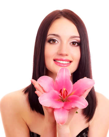 Beautiful young woman with lily flower photo