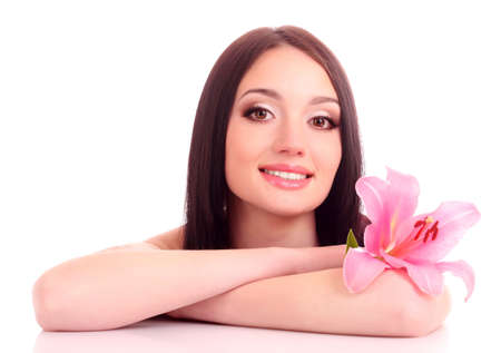 Beautiful young woman with lily flower on blue background photo