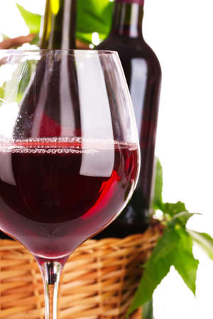 nice glass of red wine against the basket photo