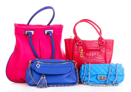 small group of objects: blue and red handbags isolated on white