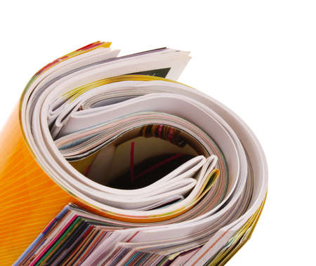 rolled up magazine on white Stock Photo - 9784984