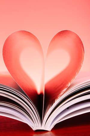pages of a book curved into a heart shape Stock Photo - 9784996