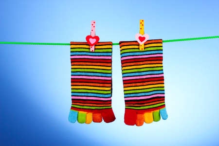 Socks hanging  on blue photo