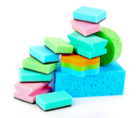 Color sponges on white background photo