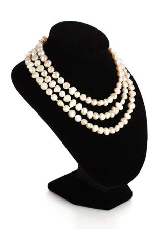 pearl necklace on a mannequin isolated on white photo