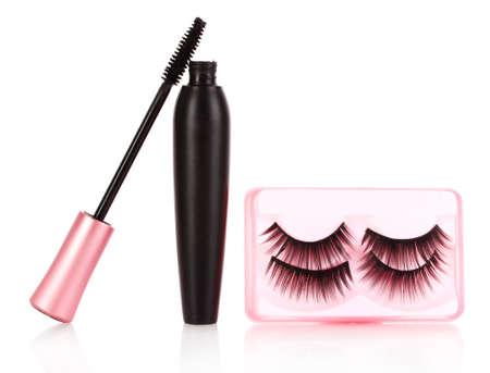 mascara and false eyelashes are isolated on a white photo