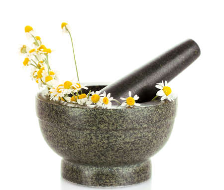 chamomile flowers in a mortar isolated on white photo