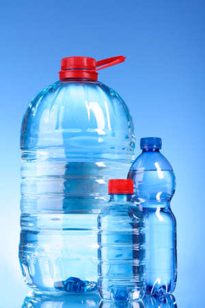 Bottles of water on blue background photo