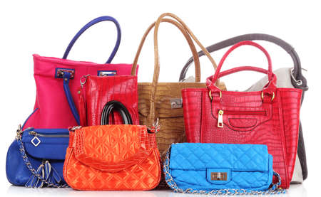 red leather texture: Many color women bags  on white Stock Photo