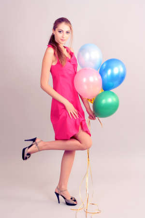 beautiful young girl with balloons on gray background Stock Photo - 9887168