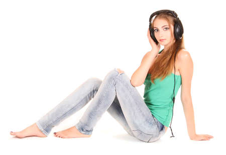 beautiful young girl in headphones isolated on white Stock Photo - 9887165
