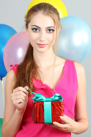 beautiful young girl with a gift in hands Stock Photo - 9887172