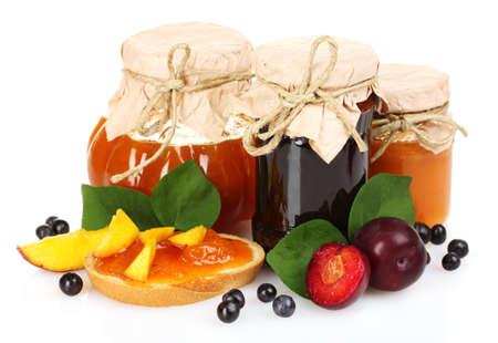 tasty fruit and berry jam isolated on white photo