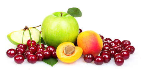 Beautiful apples, apricots and cherries isolated on white photo