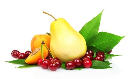 Beautiful pear, apricots and cherries isolated on white photo