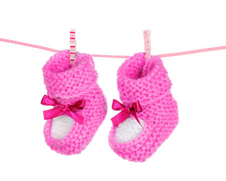 pink baby booties blue isolated on white Stock Photo - 9999369