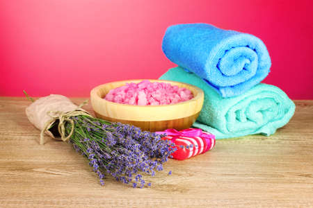 Beautiful lavender, salt and towels on a red background Stock Photo - 9999315