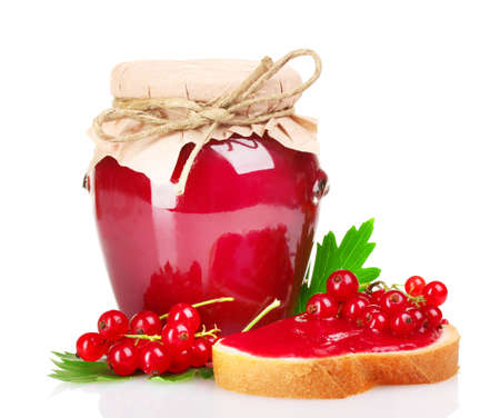 tasty currant jam and berries isolated on white photo