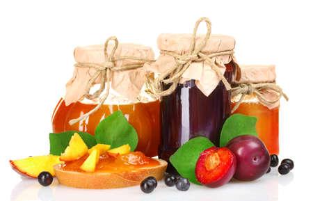 fruit jelly: tasty fruit and berry jam isolated on white Stock Photo
