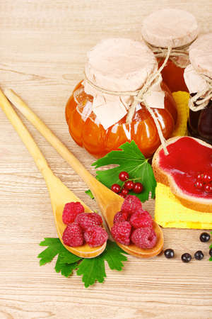tasty fruit and berry jam on a wooden background Stock Photo - 9999317
