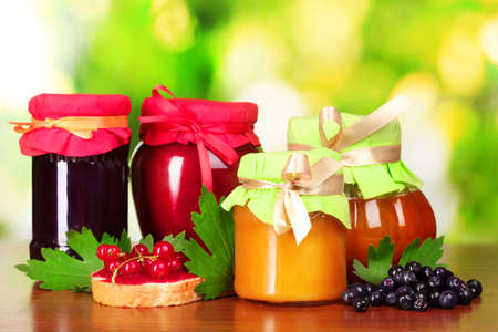 tasty berry and fruit jam and berry on a green background Listen berry and fruit jam and fruit Listen tasty berry and fruit jam and berry photo