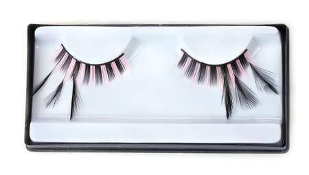 beautiful decorative eyelashes isolated on white photo