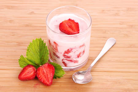 yogurt and strawberry on a wooden background Stock Photo - 9999248