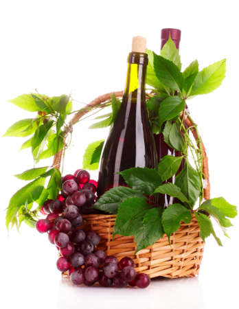 red wine and grapes in a basket isolated on white photo