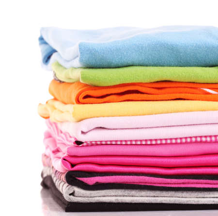 Pile of colorful clothes over white background photo