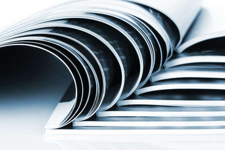 many magazines isolated on white photo