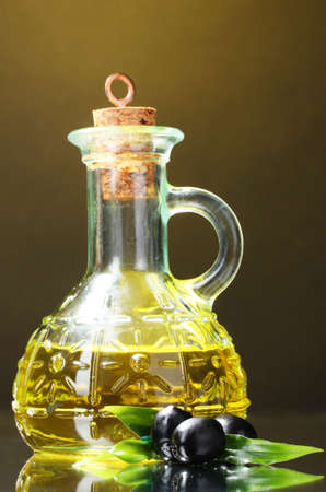 olive oil and olives on yellow background Stock Photo - 10018741