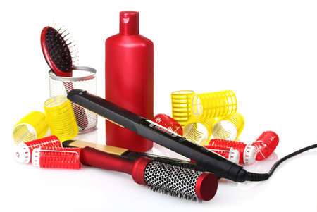 combs, curling iron and hair curlers isolated on white photo