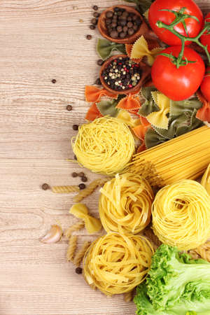 tasty vermicelli, spaghetti and vegetables on wooden background Stock Photo - 10090990
