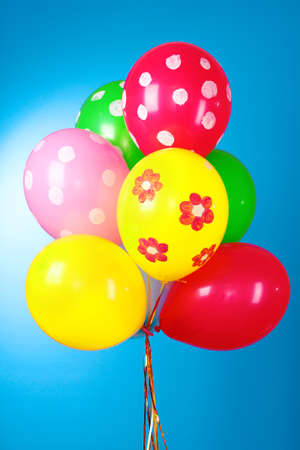 Flying balloons with polka dot on a blue background photo