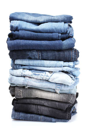 white clothes: lot of blue jeans isolated on white