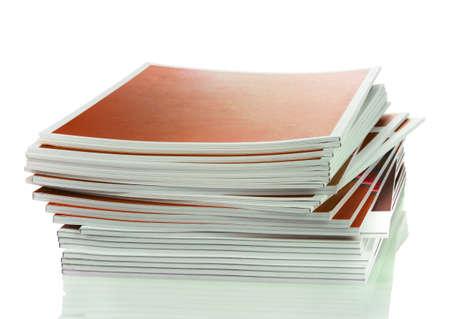 many magazines isolated on white photo
