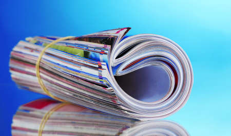 many magazines on blue background photo