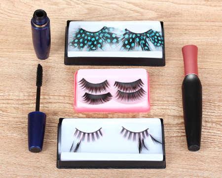 beautiful decorative eyelashes on wooden background Stock Photo - 10202427