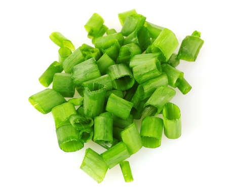 chopped green onion isolated on white photo